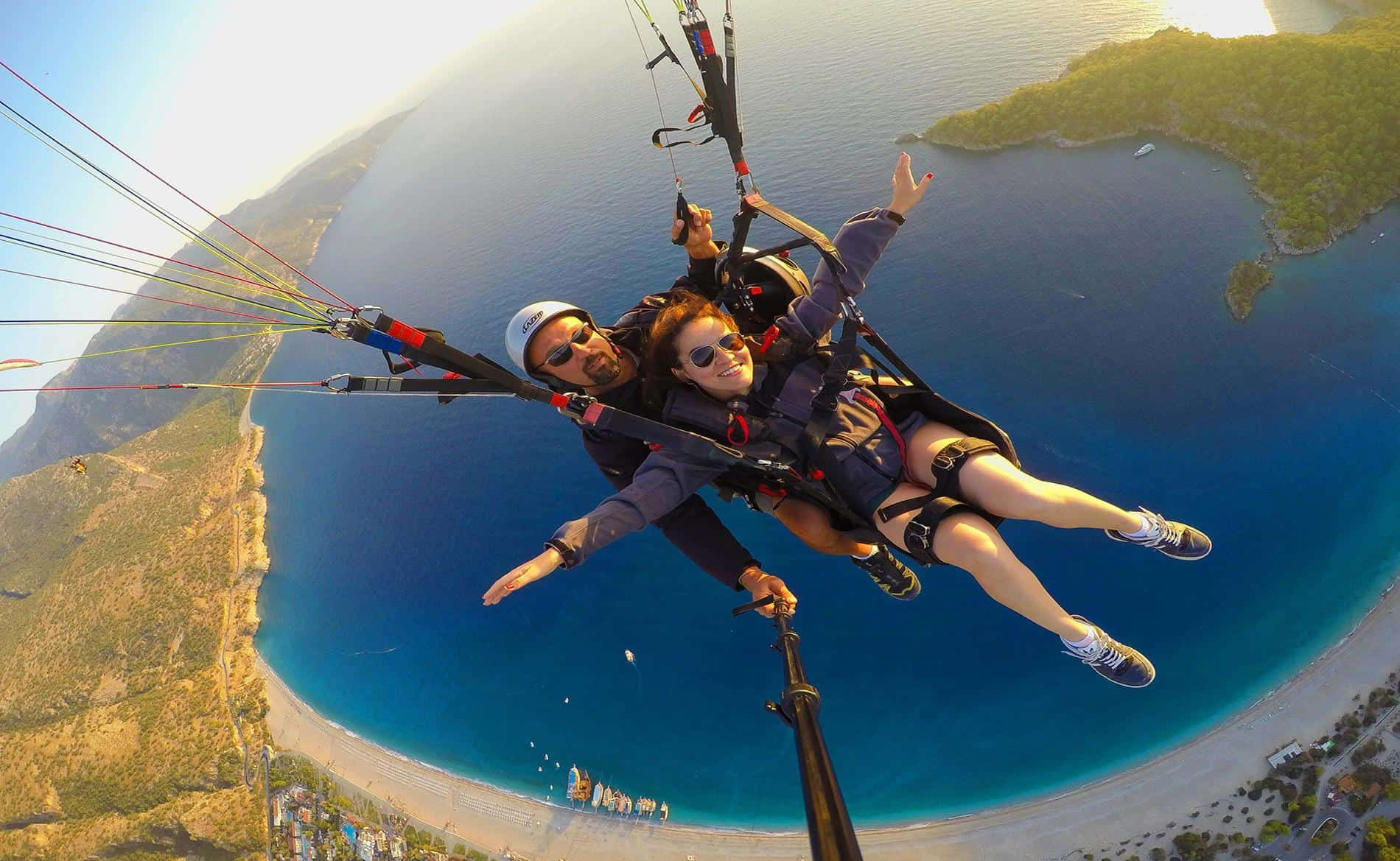 Tandem Paragliding Over Oludeniz Beach In Turkey The
