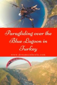 Paragliding over the blue lagoon in Oludeniz Beach Turkey